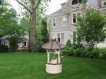 Decorate the yard with a wishing well or windmill from ...